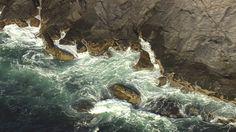 Waves crash against the rocky coast of Monhegan Island, Maine. Aerial photograph.