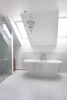 somewhat modern bathtub and very modern shower, traditional fixtures, traditional chandelier