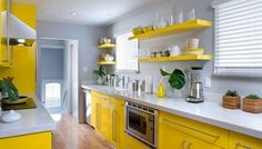Yellow kitchen colors offer great decorating ideas that brighten up modern kitchen design and bring happy mood into homes Grey Yellow Kitchen, Yellow Kitchen Designs, Yellow Kitchen Cabinets, Modern Kitchen Design, Kitchen Colors, Kitchen Countertops, Gloss Kitchen, Grey Countertops, White Cabinets