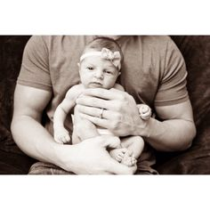 Newborn girl and her daddy. So sweet.