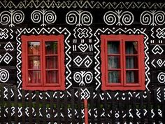 The distinctive village of Čičmany is known for its historic and unique architecture - painted, wooden houses Types Of Textiles, Arched Doors, Unique Architecture, Outdoor Art, African Design, Architectural Elements, Painting Patterns, Little Houses, Traditional House
