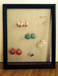 Earring holder. Picture frame with window screen hot glued to the back. DIY