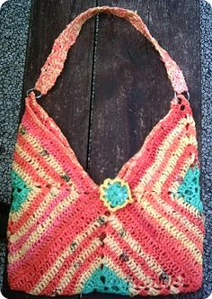 Nice granny bag made from recycled plastic bags.  Great colors - 3 large granny squares and a strap.