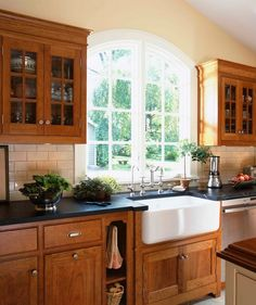 I like the combination of soapstone countertops and the wood cabinets. Not really feeling the sink, tho.