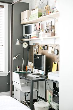 office pegboard wall - love, love, love this idea for office closet area. Would brighten up the space (if board painted and allow us to hang up important items)