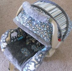 "Infant Car Seat Cover/Canopy "" Zoology"" made for Graco up to 30 lbs and other models. $99.99, via Etsy."