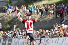 Levi-Leipheimer-USA-Pro-Cycling-Challenge-winner-2011 .. Stage 2 Crested Butte Photo: Robertson/Velodramatic) ... how much do I love that my hubby and I are in the photo -- blurry and looking the other way to take photos of those trying to catch Levi .. but there none-the-less!