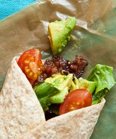 BLTA Wraps with mashed avocado, lemon juice, crumbled bacon, chopped tomatoes, sliced romaine lettuce wrapped in a whole wheat tortilla