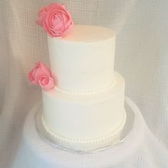 Classic two tiered wedding cake with gum paste peonies