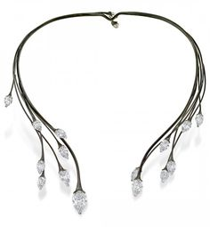 DIAMOND SPRAY NECKLACE Blackened white gold branches sprout delicate diamond leaves