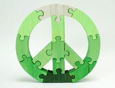 You can call this a green peace sign or greenpeace. :)  12 'peace' puzzle that can be used as room deco as well as a fun escape.