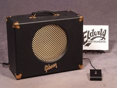 "GIBSON GA-15RV: 1X12 (Celestion Vintage 30) Goldtone Series 15 watt all-tube guitar combo amplifier, two EL84 power tubes in a class A circuit (think Vox AC15), two 1/4"" inputs (low and high), high (Pentode) and low (Triode) power switch, volume, tone and reverb controls, bright switch, 1/4"" footswitch jack, 1/4"" external speaker jack (16 ohms), black tolex covering, built in the U.K."