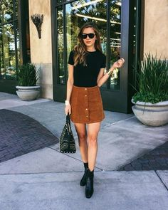 A simple tan button skirt and black top has become a high street staple. | The Hottest Fashion News: Corduroys Are Back Big Time!