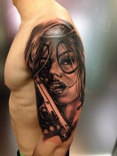 6f54491c9 school style colored shoulder tattoo of sexy clown woman with pistol  Chicano Style
