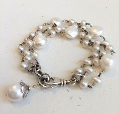 Chunky Pearl Bracelet--Wire Wrapped White Pearls by leslielewisdesigns on Etsy https://www.etsy.com/listing/205756165/chunky-pearl-bracelet-wire-wrapped-white