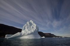 An iceberg floats in the sea near Qeqertarsuaq, Disko Island, Greenland, on July Global warming is shifting the way the Earth wobbles on its polar axis, a new NASA study finds. Greenland Ice Sheet, Greenland Travel, Institute Of Physics, Ice Giant, Iceberg, Solar Activity, What Lies Beneath, Sea Level Rise, Planets