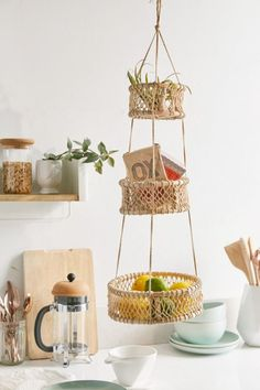 hanging baskets Wood + cotton netted hanging basket, found exclusively at UO. Three concentric baskets in a tiered construction, perfect for displaying fruit + plants in the k Boho Kitchen, Diy Kitchen, Kitchen Storage, Kitchen Design, Kitchen Ideas, Hippie Kitchen, Colorful Kitchen Decor, Kitchen Baskets, Lemon Kitchen