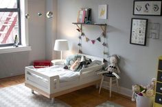 oeuf toddler bed, wall gallery with wire initial, two rugs to unify the space