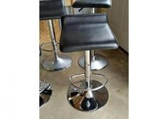 Chrome base adjustable bar stools with vinyl seats