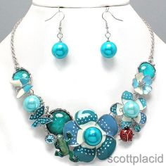 """CHUNKY BLUE MIX EPOXY and ACRYLIC FAUX PEARL FROG, BUTTERFLY, FLOWER, AND LADYBUG THEME SILVER TONE NECKLACE SET     * If you need a necklace extender I have them for sale in my store.*         NECKLACE: 17"""" L + 3"""" EXT    DROP: 1 3/4"""" LONG       HOOK EARRINGS: 1 3/4"""" LONG           COLOR: SILVER TONE  $21.99"""
