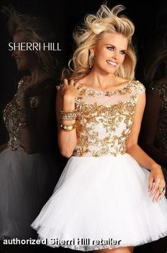 Sherri Hill dress 21032. A stunning and sophisticated dress perfect for any occasion! Short dress with heavily beaded and sequned bodice, cap sleeves and open back.