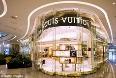 Boost: Designer fashion houses such as Louis Vuitton can benefit from the sale of counterfeit products, according to a new study