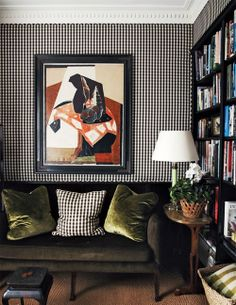 Check out the pillow on this lovely couch tying into the wallpaper. Amazing. This is a great room.