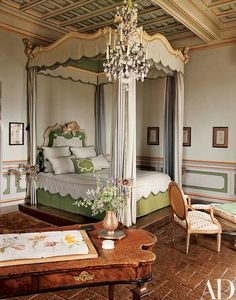 Hung with yards of Indian silk, an 18th-century baldachin bed makes a romantic statement in a guest room. Gnoli painted the tulip studies that encircle the space | archdigest.com canopy bed