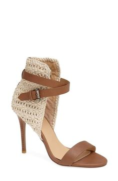 On trend! Woven sandal with tan leather strap and buckle.