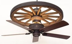 A Rustic Lighting and Fans exclusive! The Copper Canyon Cheyenne Wagon Wheel Ceiling Fan feature a molded and hand painted resin wagon wheel replica...