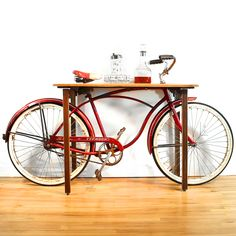 A Bicycle Bar table. I would love to see a DIY version of this! A great table to set your Cascaderade IPL on!