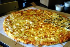 The Four Seasons, four classic Yellow Cab pizza flavors in one awesome pizza, the NY Classic, 4 Cheese, Anchovy Lovers, and Roasted Garlic and Shrimp.