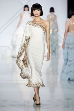 Ralph & Russo Spring 2017 Couture: I like the one shoulder detail with the long ruffle sleeve. Exquisite gold trim.