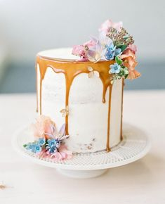 Drippy caramel and petite pastel blooms atop this dainty cake from Aga G. We love the idea of mini cakes for each and every guest! photo florals cake Aga G Spring Wedding Decorations, Wedding Ideas, Wedding Bride, Wedding Reception, Wedding Inspiration, Bouquet Wedding, Wedding Themes, Wedding Nails, Wedding Flowers