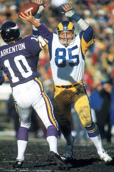 Vikings' QB, Fran Tarkenton, alluding Rams' DE, Jack Youngblood during a Rams/Vikings game, Circa 1975.