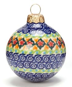 Trim the tree with handmade touches. This signature patterned, hand-painted piece comes from Poland and will look right at home nestled in the branches next to first grade art projects and hanging crafts.3'' H x 2.5'' diameterStonewareLead-freeHand wash