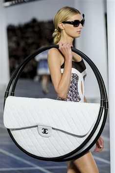 Karl Lagerfeld's huge Hula Hoop Bag. Hit the image for a video of Lagerfeld explaining how to use it.
