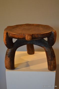 A nicely styled Hehe stool from Tanzania.  Although elegantly carved, these three legged stools are considered everyday objects and are also used  for sitting whilst milking cows / goats.