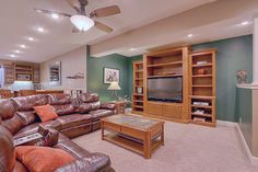 The home flows seamlessly into an awesome finished daylight basement with 9ft ceilings, featuring built-in entertainment center.