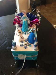Addy's Frozen shoe box float- we used sequin ball ponies to make beautiful snowballs, printed paper dolls offline and assembled them, used a strand of beads for the pull string - some headbands to decorate the sides of the float