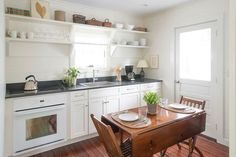 Eat in kitchen with seating for four Granite countertops
