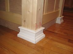 """Beef up a kitchen island with board/batten, 2x4 corners, and molding """"feet"""""""