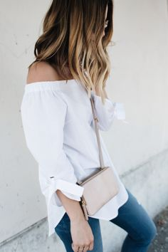 Michelle Madsen rocking the Off-the-shoulder trend in the Babaton Malik blouse