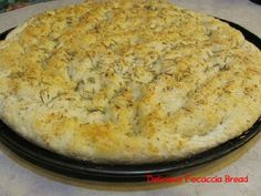 Bread Machine Focaccia Bread-- good for paninis. Used white whole wheat flour, haven't had the parmesan to try on top.