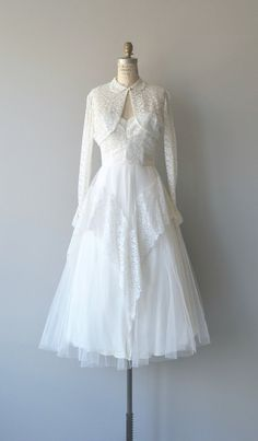 Vintage 1950s wedding dress with strapless lace, crumb-catcher bodice, corset…