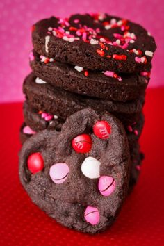 ~` chocolate heart cookies made using my favorite chocolate cookie recipe .  the heart shape comes from baking them in a whoopie pie pan! `~
