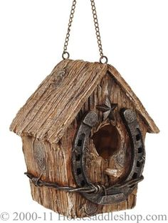 Rustic birdhouse (looks like old cedar fencing) with horseshoe (correct side up for luck and perching), star, and barbed wire
