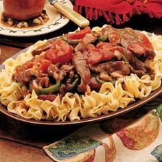 Pepper Steak Recipe.... they show it over egg noodles... but I think over rice would be nice :)