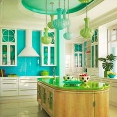 love the colors. Large glass tiles look great in this kitchen by Anthony Baratta