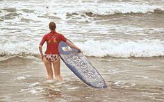 Surfer Woman is Surfing in Bikini